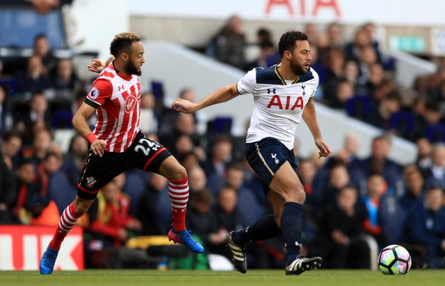 Mousa Dembele holds off Southampton's Nathan Redmond