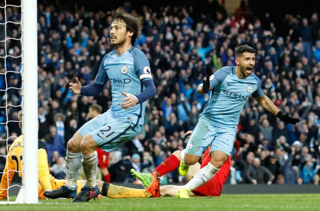 David Silva and Sergio Aguero celebrate the latter's goal.