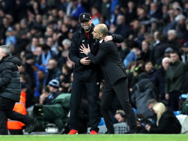Jurgen Klopp, left, and  Pep Guardiola share  a joke