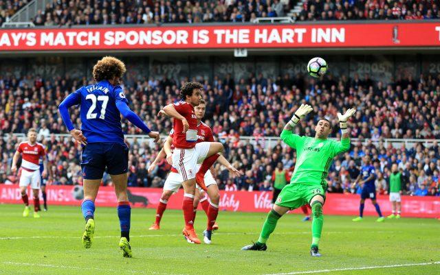 Marouane Fellaini heads in Manchester United's first goal