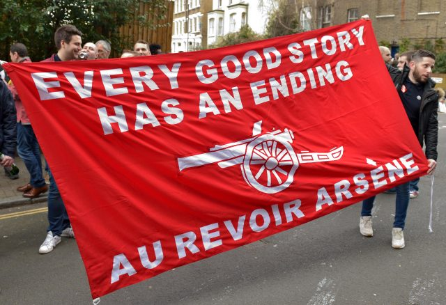 Arsenal fans holds up a sign against Arsenal manager Arsene Wenger at Finsbury Park