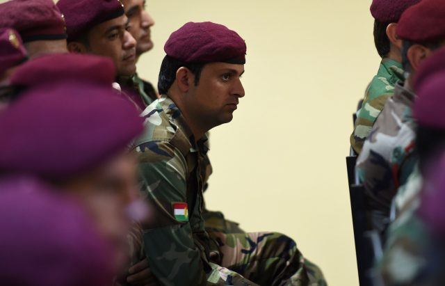 A soldier listens to a briefing