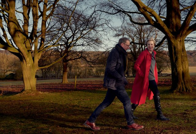 Theresa May goes for a walk with her husband Philip in an Egg coat and a Sine for Egg sweater in a photograph taken for American Vogue