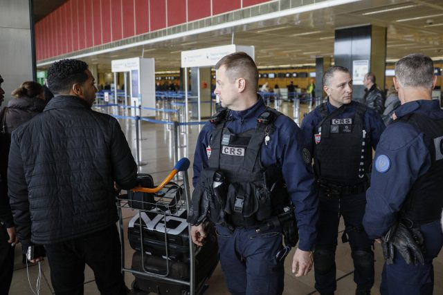 Riot police officers patrol inside Orly airport