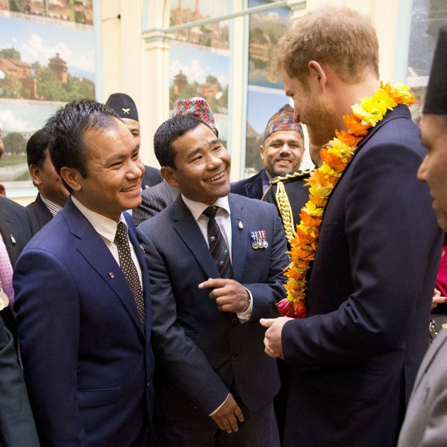 Prince Harry meets 37-year-old Corporal Hair Budha Magar, left, and Rifleman Vinod Budhathoki, two Gurkhas who he served with in Afghanistan at the Embassy of Nepal