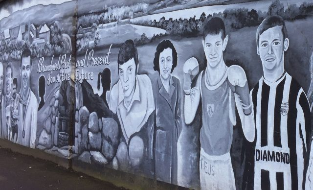 A mural in Brandywell, Derry, featuring Derry City captain Ryan McBride, right
