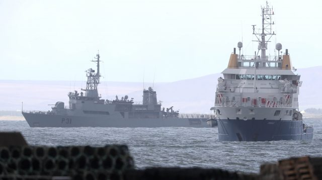 The Irish Naval Service vessel L.E. Eithne (rear) and the search vessel Granuaile continue the search in Blacksod Bay