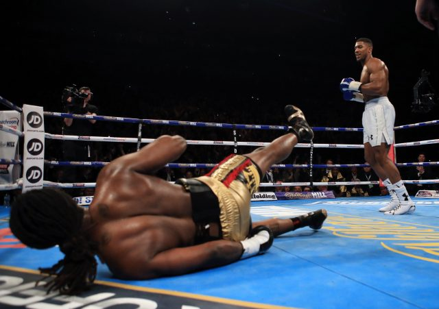 Anthony Joshua  knocks down Charles Martin (Nick Potts/PA)