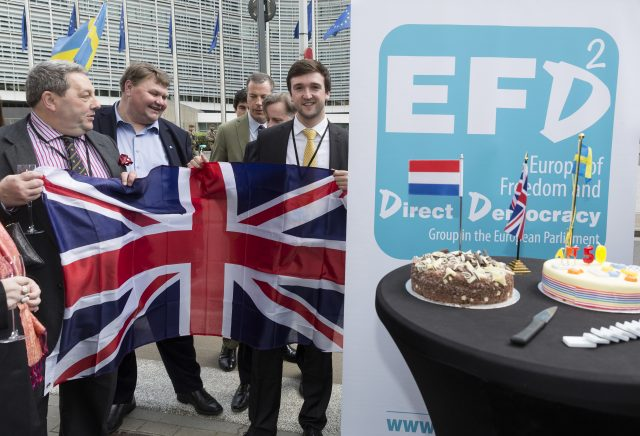 Scottish UKIP member David Coburn, left, holds a Brisith flag as h celebrates the official triggering of Article 50 of the Lisbon Treaty in Brussels