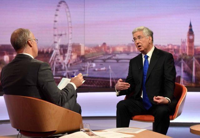 Sir Michael Fallon talks to presenter Eddie Mair (Jeff Overs/BBC/PA)