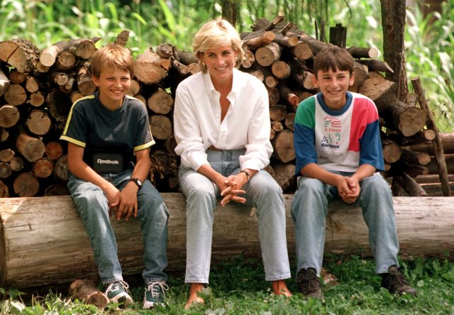 Diana, Princess of Wales meets Malic Bradoric, left, a Muslim boy and Serb Zarco Beric, both of whom have been injured by landmines, near Tuzla in Bosnia