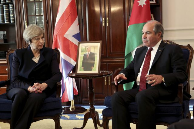 Theresa May, left, meets Jordanian Prime Minister Hani al-Mulqi