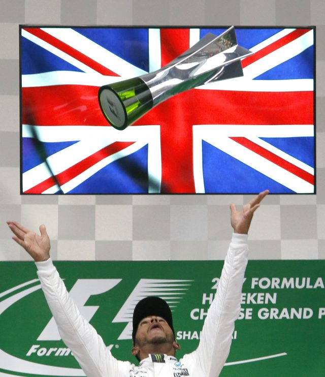 Mercedes driver Hamilton wins Chinese GP from pole