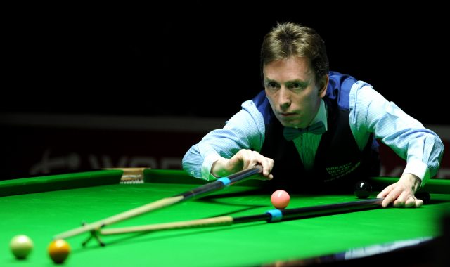 Ken Doherty plays a shot during his match at the World Championship Qualifying rounds