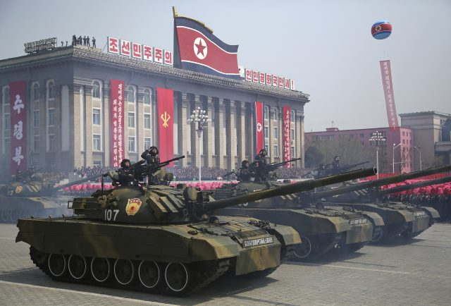 North Korea unveils new missiles during military parade