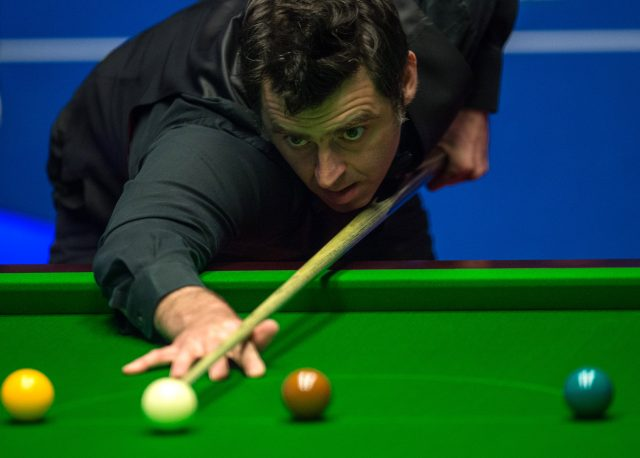 Reigning world champion Selby races into second round