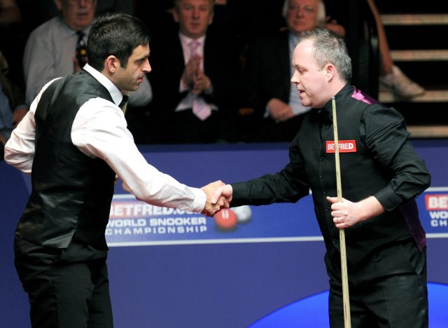 Ronnie O'Sullivan and John Higgins (Nigel French/PA)