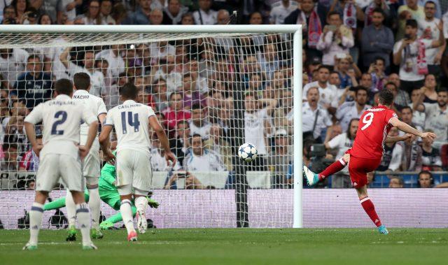 Bayern Munich's Robert Lewandowski scores his side's first goal (Mike Egerton/Empics)