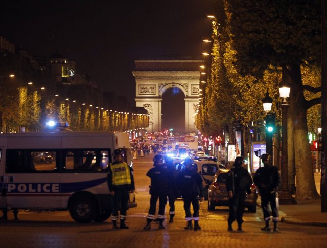 Police seal off the Champs Elysees avenue