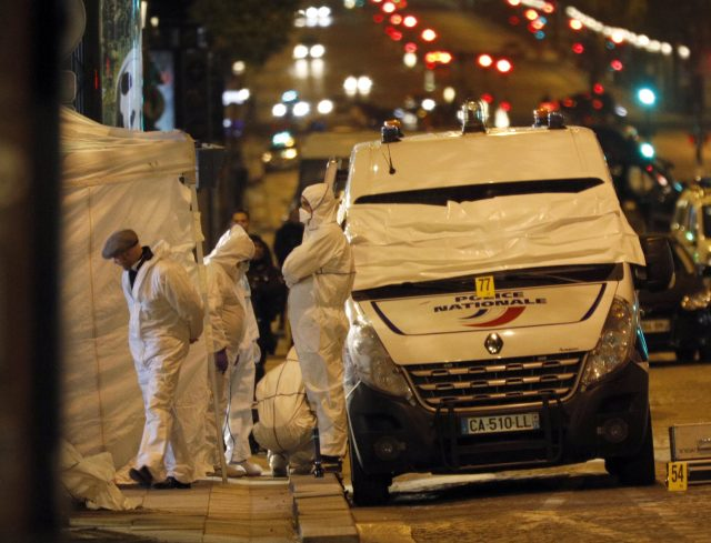 Forensic experts investigate the crime scene  in Paris
