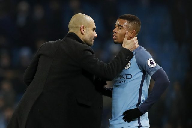 Manchester City manager Pep Guardiola (left) and Manchester City's Gabriel Jesus after the final whistle during the Premier League match at the Etihad Stadium, Manchester.