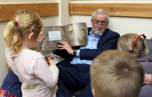 Labour leader Jeremy Corbyn reads with children as he visits Brentry Children Centre in Bristol (Steve Parsons/PA)
