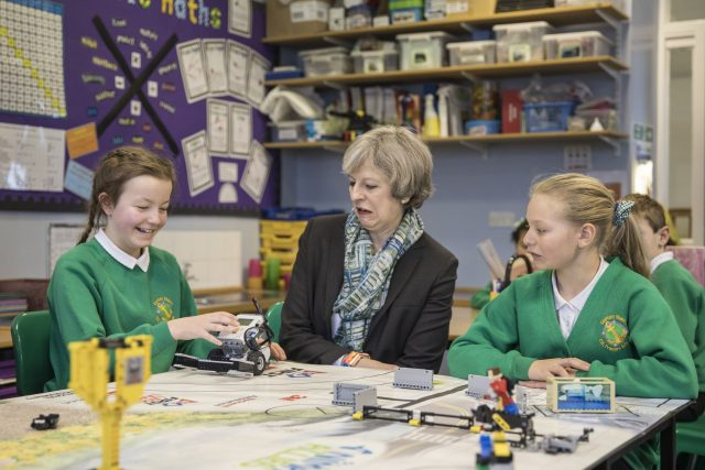 Prime Minister Theresa May sitting with year six pupils during a visit to Captain Shaw's Primary School in Bootle, Cumbria (Jack Hill/The Times/PA)