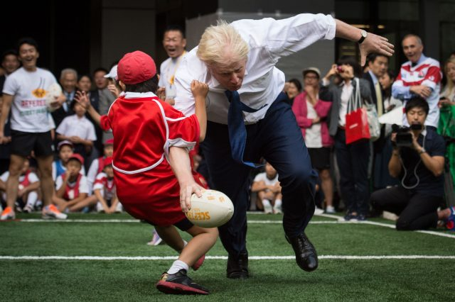 Mayor of London Boris Johnson joins a Street Rugby tournament in a Tokyo street with school children and adults from Nihonbashi, Yaesu and Kyobashi Community Associations (Stefan Rousseau/PA)