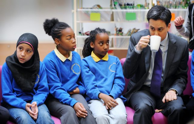 Labour leader Ed Miliband meets school children during a visit to the Michael Faraday School in Southwark (Stefan Rousseau/PA)