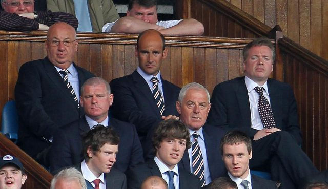 Then Rangers owner Craig Whyte, right, in the directors' box at Ibrox with Walter Smith, middle row right