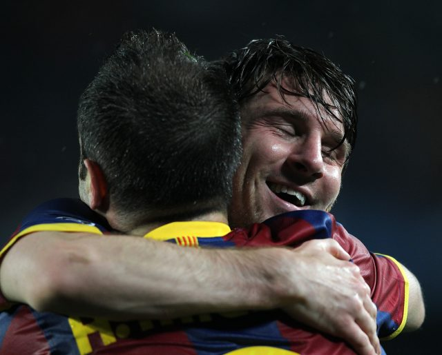 Lionel Messi, right, celebrates with Andres Iniesta, left