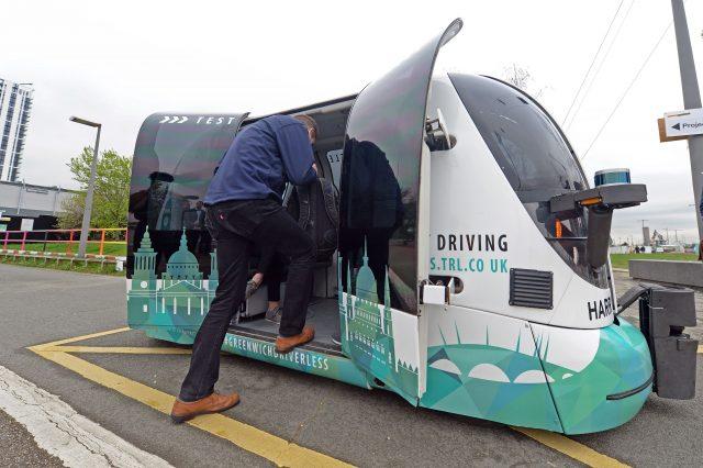 A passenger boarding a driverless service in Greenwich