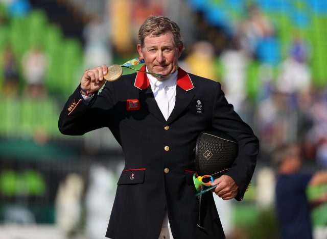 Great Britain's Nick Skelton holds up his gold medal at the 2016 Olympics in Rio