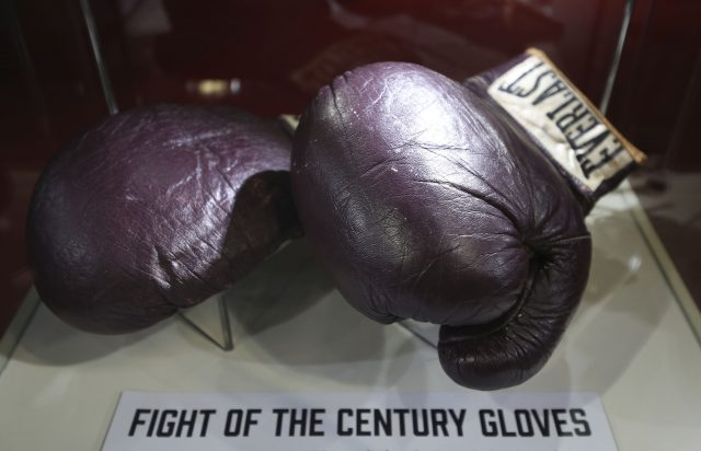 Boxing gloves worn by Muhammad Ali in his fight with Joe Frazier in 1971 billed as the fight of the century, on show ahead of the I Am The Greatest: Muhammad Ali in London