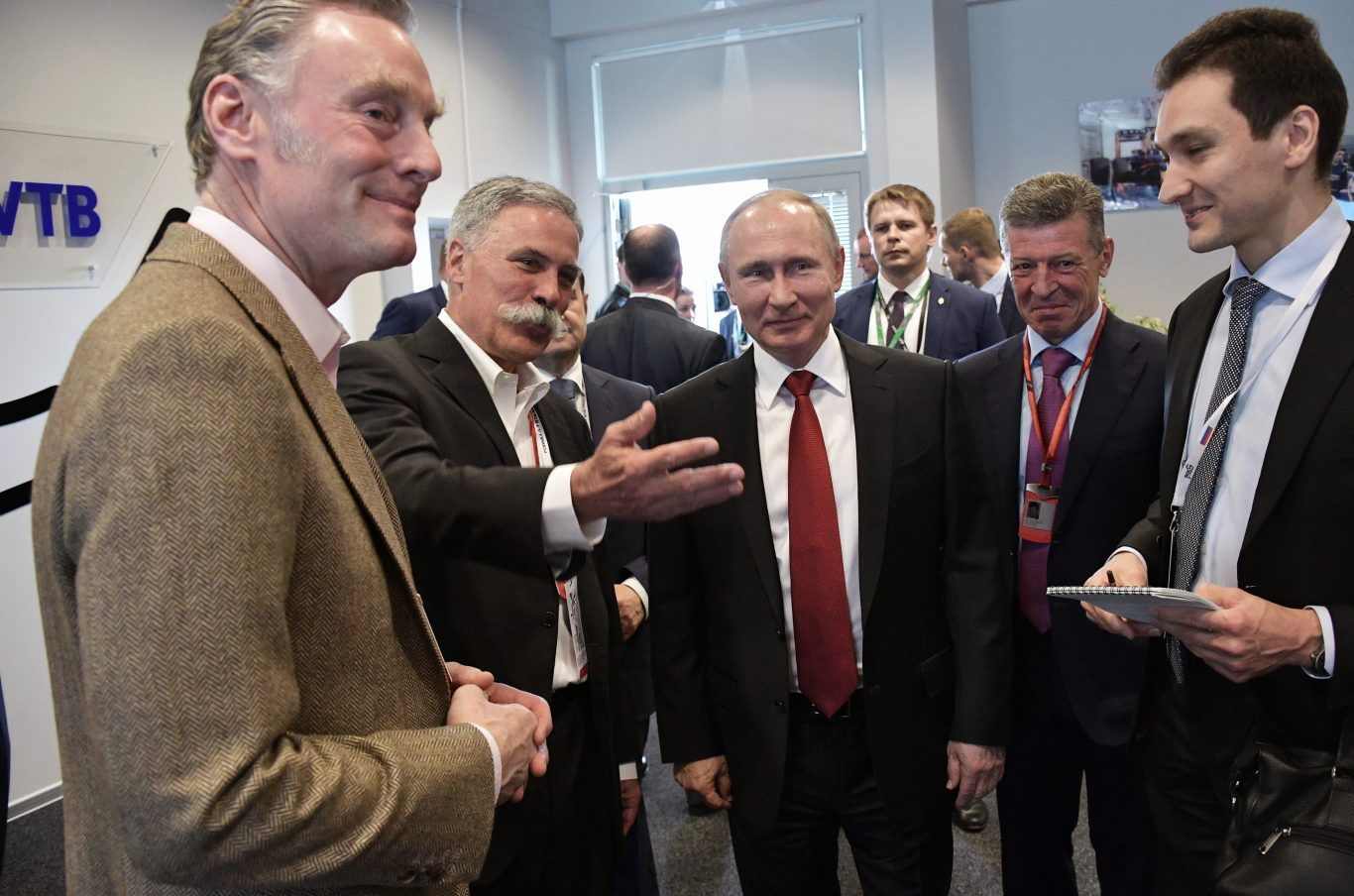 Russia's president Vladimir Putin, center, listens to Chase Carey