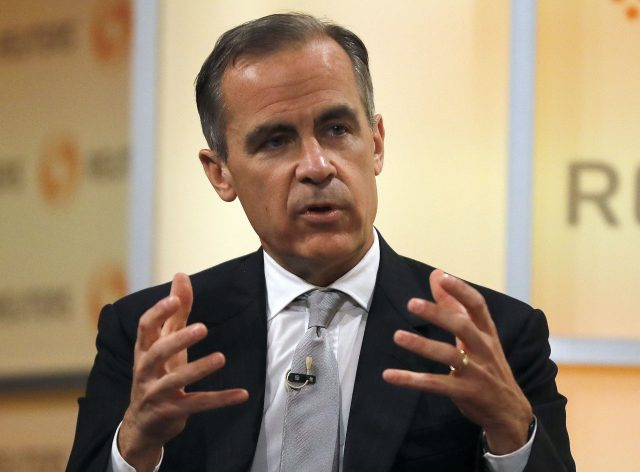 Bank of England keeps rates at record low as economy slows