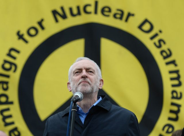 Theresa May and Jeremy Corbyn get personal over defence on election trail