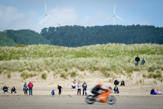 A motorcycle rider races in the Straightliners 'Top Speed' event at Pendine Sands