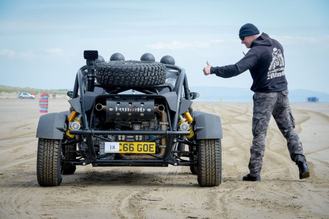 An Atom Nomad off road style vehicle is given the thumbs up to start in the Straightliners 'Top Speed' event at Pendine Sands, Wales