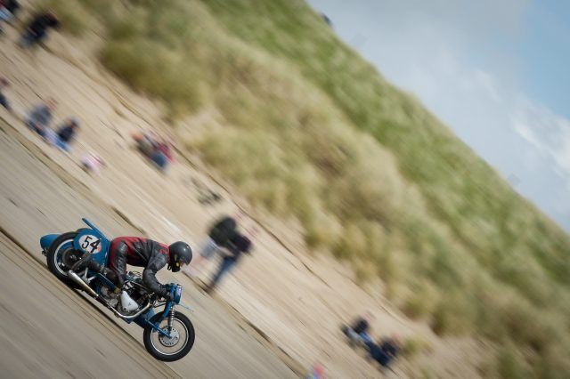 A side-car bike rider races in the Straightliners 'Top Speed' event at Pendine Sands