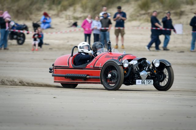 Michael Portillo rides a Morgan three-wheel vehicle