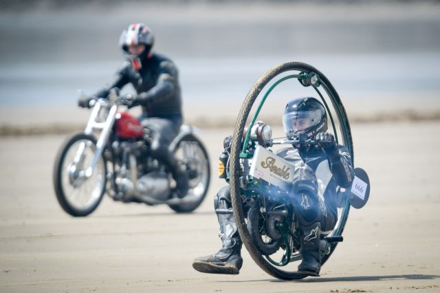 Tom Anable, from Lincolnshire, rides his monowheel bike in the Straightliners 'Top Speed' event at Pendine Sands, Wales