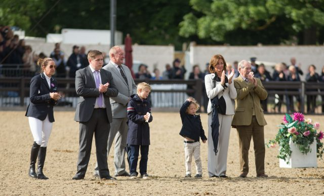 Nick Skelton's family watch as he walks his horse Big Star around the arena (Steve Parsons/PA)