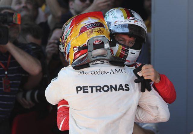 Lewis Hamilton and Sebastian Vettel embrace after the Spanish Grand Prix