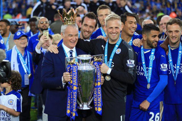 Claudio Ranieri holds the Premier League trophy alongside Kasper Schmeichel