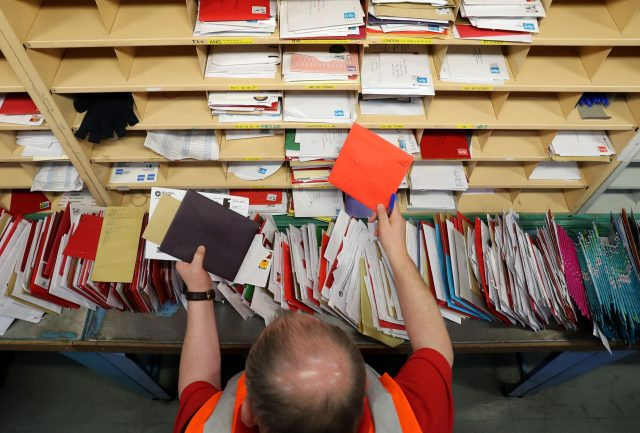Royal Mail profit falls, expects letter volume decline