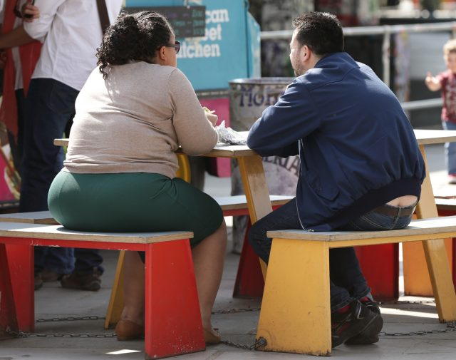 Overweight people at a table