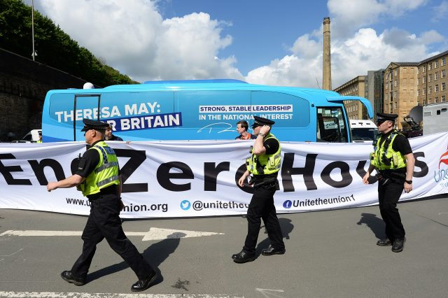 Police and protesters in Halifax before Theresa May launched her party's general election manifesto (Stefan Rousseau/PA)