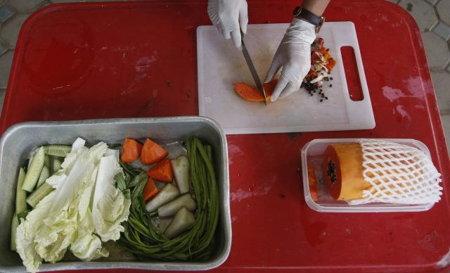 Vets now prepare fresh food for Uncle Fat (Sakchai Lalit/AP)