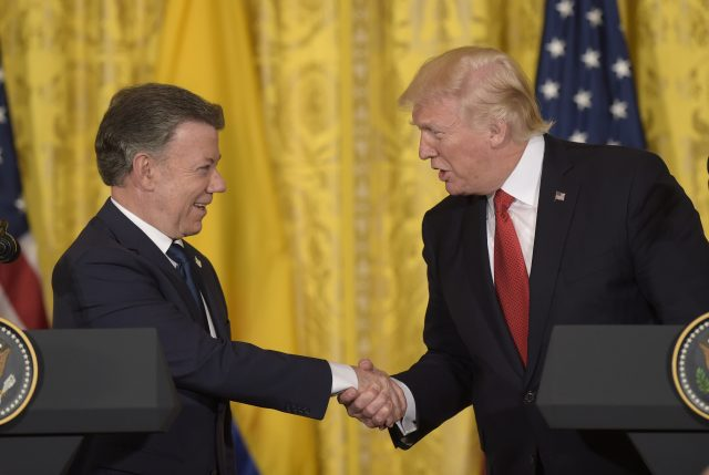 Donald Trump shakes hands with Colombian President Juan Manuel Santos
